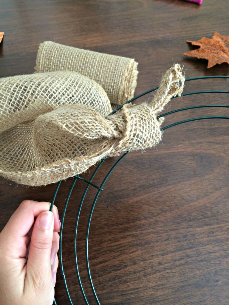 Tie the burlap to the wreath frame.