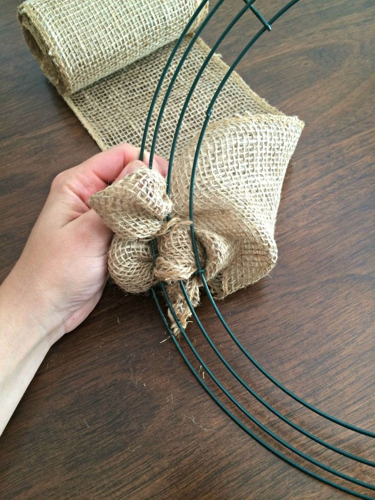 """Pull the burlap out of the wreath frame to create a """"bubble"""" or """"loop."""""""