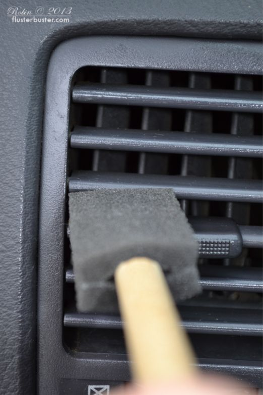 13. Clean out your car's air vents using a foam brush