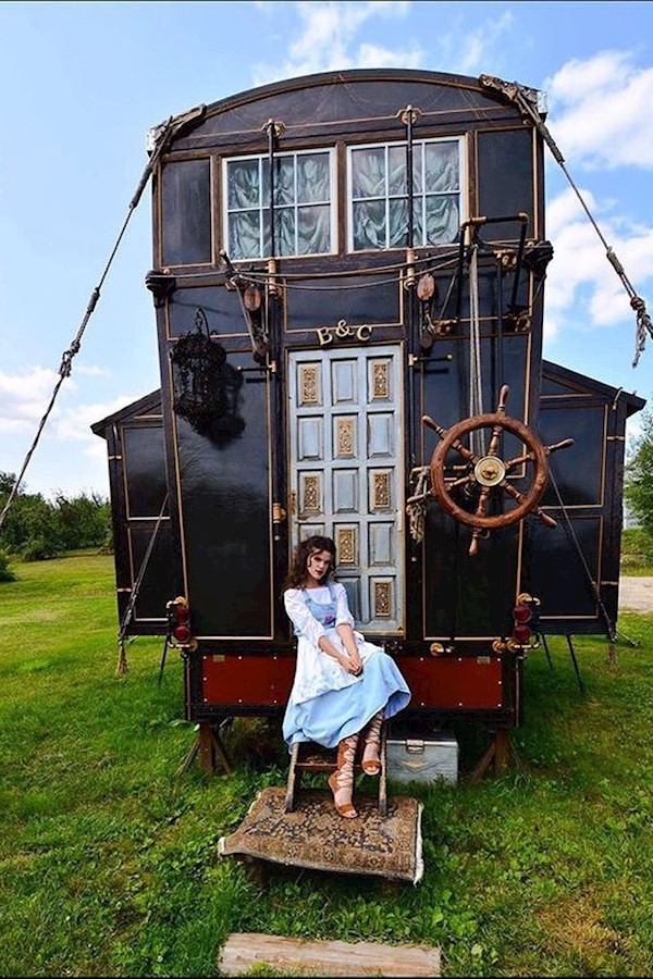 """Handmade tiny home on wheels by @chloebarcelou and her fiancé, has custom made expandable roof hoist using the ships wheel, and t"